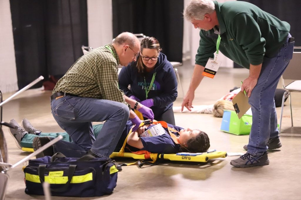 teachers showing how to do various EMS work.