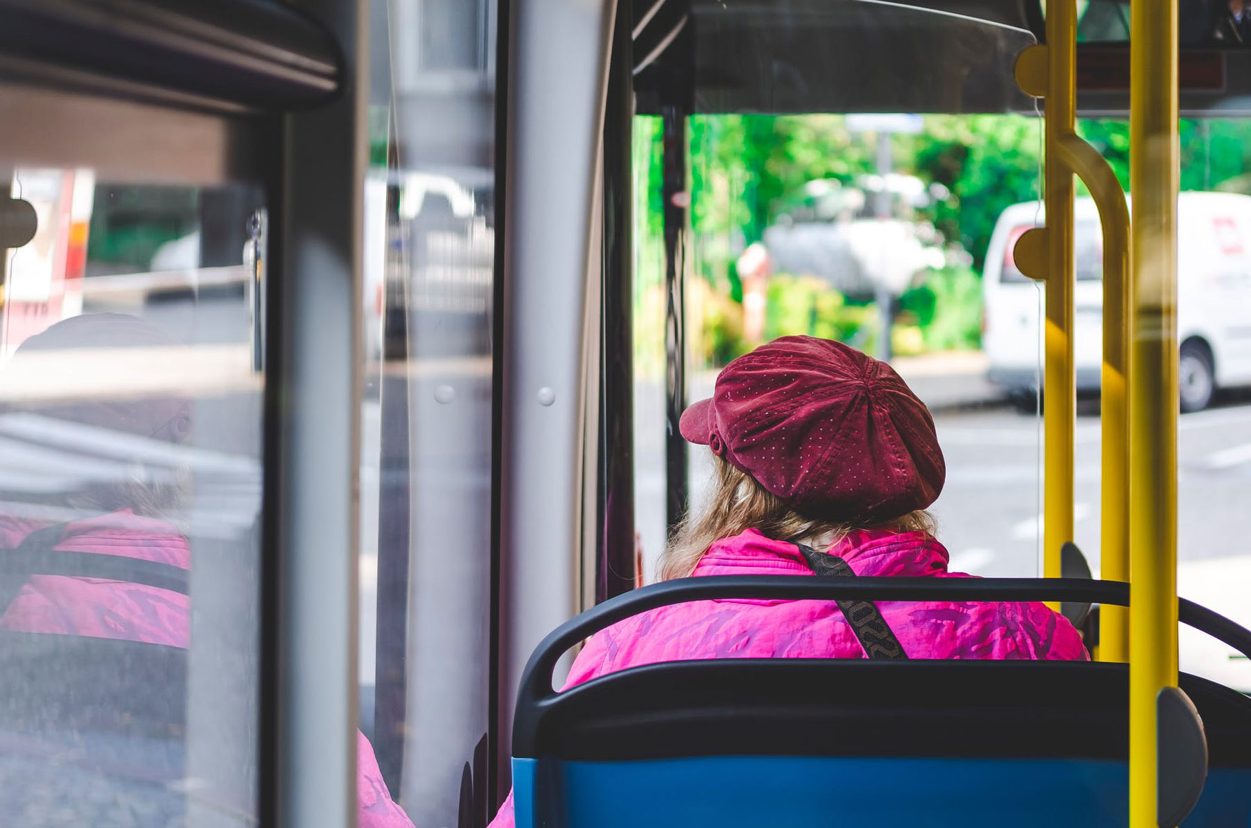 Woman riding on a bus.
